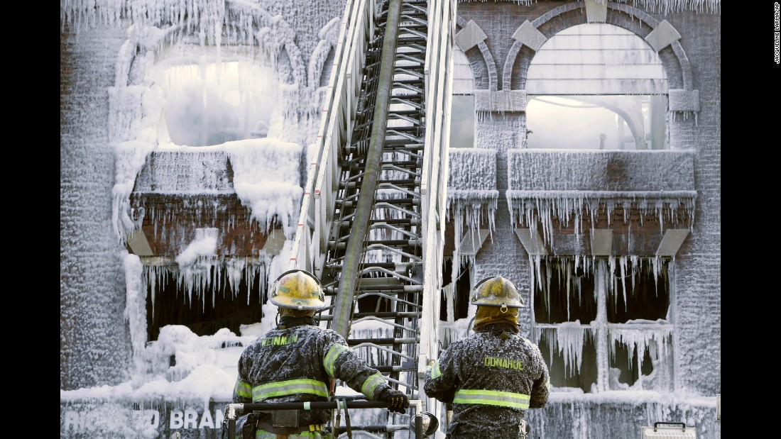 <strong>February 16:</strong> Philadelphia firefighters work at the scene of an overnight blaze. The cold weather made icicles out of their water.