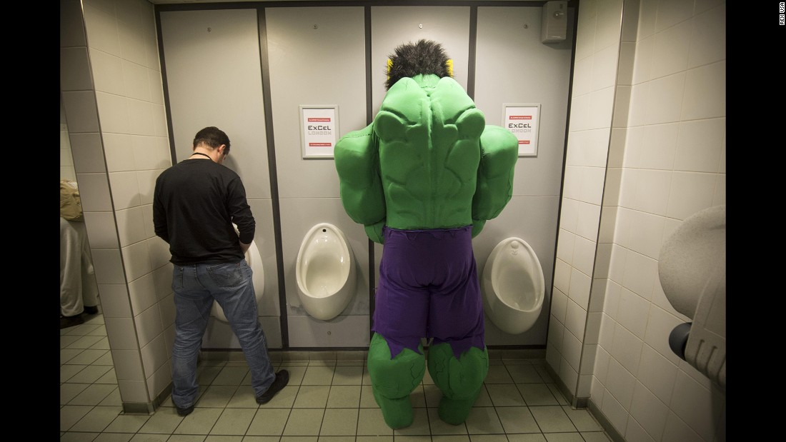 <strong>March 14:</strong> A man dressed as the Incredible Hulk uses the restroom during the London Super Comic Convention.