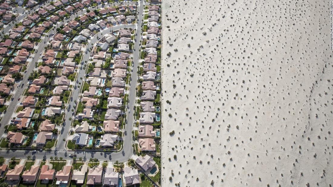 """<strong>April 3:</strong> A housing development meets the edge of undeveloped desert in Cathedral City, California. California Gov. Jerry Brown <a href=""""http://www.cnn.com/2014/07/17/us/gallery/california-drought/index.html"""" target=""""_blank"""">imposed mandatory water restrictions</a> on residents, businesses and farms in the drought-ravaged state, ordering cities and towns to reduce their usage by 25%."""