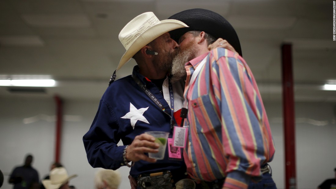 <strong>April 24:</strong> Gordon Satterly, left, kisses his husband, Richard Brand, at a party held in Little Rock, Arkansas, by the International Gay Rodeo Association.