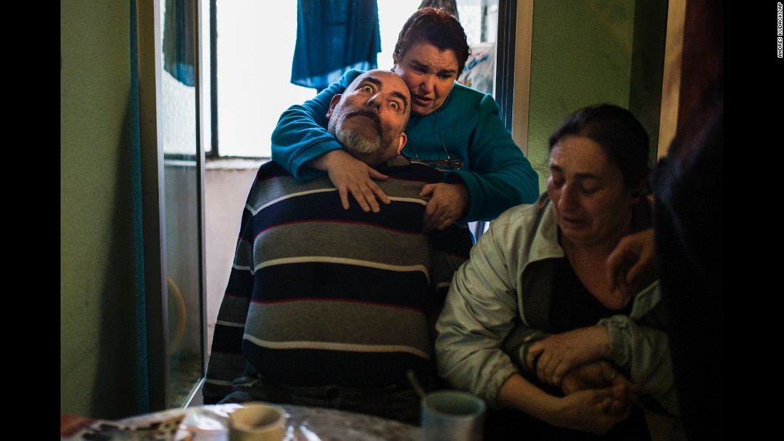 <strong>April 28:</strong> Juan Montiel suffers an epileptic seizure as his wife and sister attend to him in Madrid. The family was being evicted from their apartment despite protests by housing rights activists. Evictions in Spain have soared since the country's economic crisis began in 2008, and protesters regularly try to prevent them.