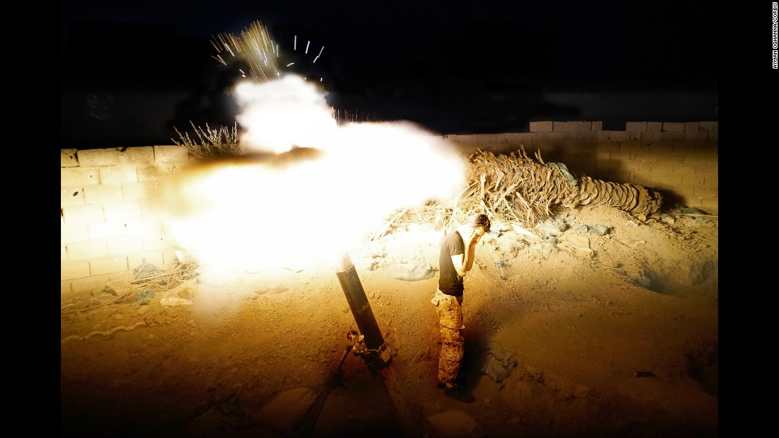 "<strong>May 10:</strong> A member of the Iraqi Army fires mortars on ISIS positions in Ramadi, Iraq, days before the city <a href=""http://www.cnn.com/2015/05/17/asia/isis-ramadi/"" target=""_blank"">fell to the militant group.</a>"