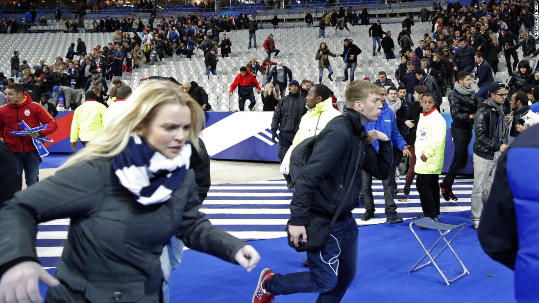 "<strong>November 13:</strong> Spectators run onto the soccer field at the Stade de France stadium, one of the targets of <a href=""http://www.cnn.com/2015/11/14/world/what-happened-in-paris-attacks-timeline/"" target=""_blank"">the Paris terror attacks</a> that killed at least 130 people and wounded hundreds more. The militant group ISIS has claimed responsibility for the attacks, which also hit a concert hall and popular restaurants."