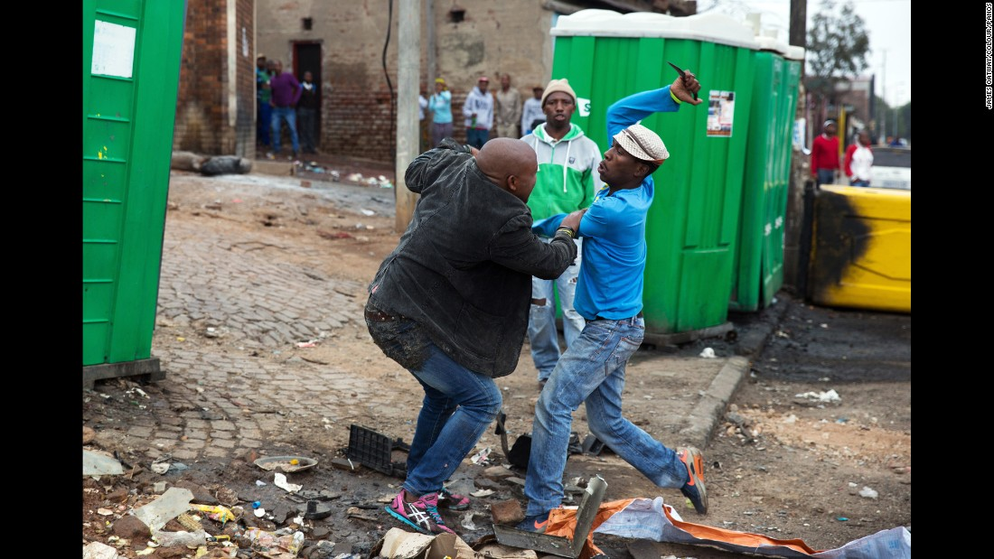 "<strong>April 18:</strong> Mozambican Emmanuel Sithole, left, was walking down a street in Johannesburg's Alexandra Township when four men surrounded him. Sithole pleaded for mercy, but it was already too late. The attackers bludgeoned him with a wrench and stabbed him with knives, killing him in broad daylight. <a href=""http://www.cnn.com/2015/04/20/africa/south-africa-xenophobia-killing-photos/"" target=""_blank"">Photographer James Oatway was nearby</a> and captured it all on his camera. It was the morning after a night of unrest that saw foreign-owned shops looted and destroyed. At least seven people were killed in xenophobic violence against poorer immigrants."