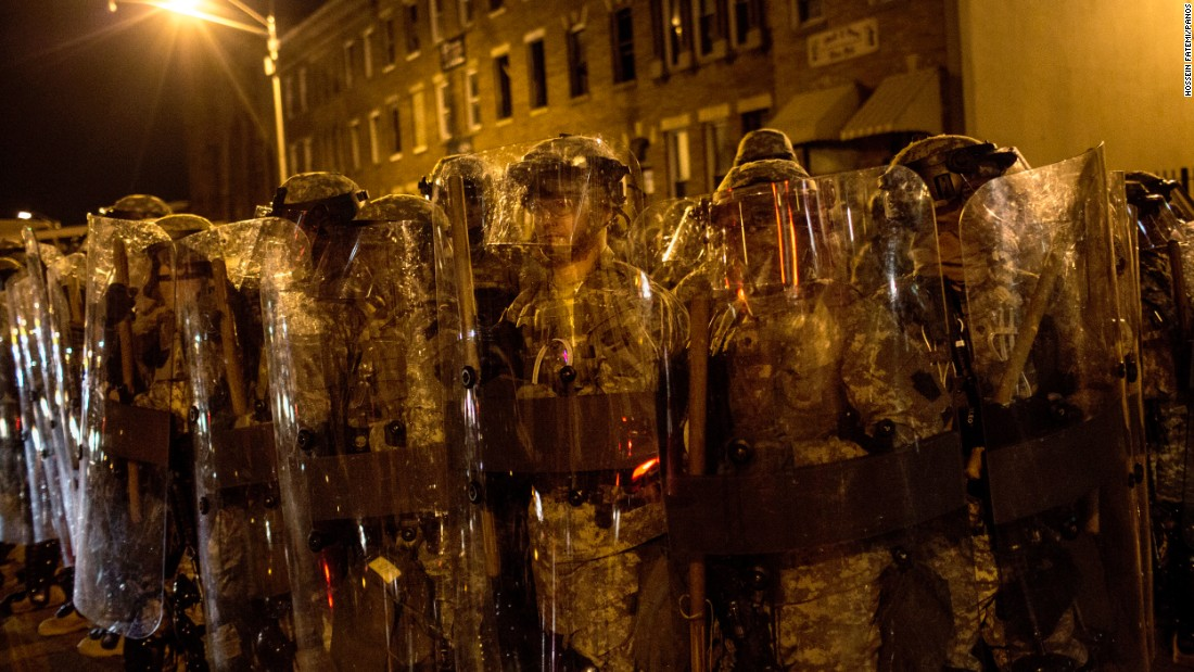 "<strong>May 1:</strong> Riot police in Baltimore enforce a 10 p.m. curfew, clearing the streets of protesters and media in the <a href=""http://www.cnn.com/2015/04/27/us/baltimore-riots-timeline/"" target=""_blank"">aftermath of Freddie Gray's death.</a> In response to an outbreak of violence, authorities <a href=""http://www.cnn.com/2015/05/04/us/freddie-gray-baltimore-protests/"" target=""_blank"">imposed a citywide curfew</a> from April 27 to May 3."