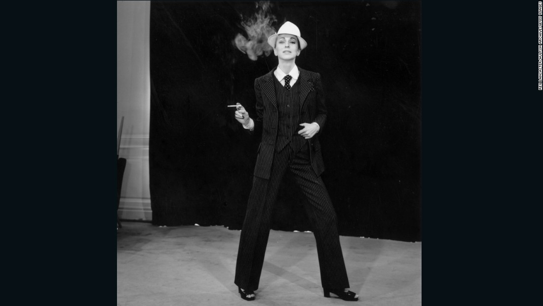 "He's commonly credited for legitimizing ready-to-wear in the eyes of fashion's elite. But in terms of design, the creation of <em>le smoking</em>, a tuxedo for women, was what he was most notorious for.  <br /><br />""He was scandalous and really reflected change -- the sexual revolution, the rise of liberal beliefs in France -- in a glamorous way."" <br /><br /><em>A model wears a pinstripe Yves Saint Laurent </em>smoking,<em> 1967</em>"