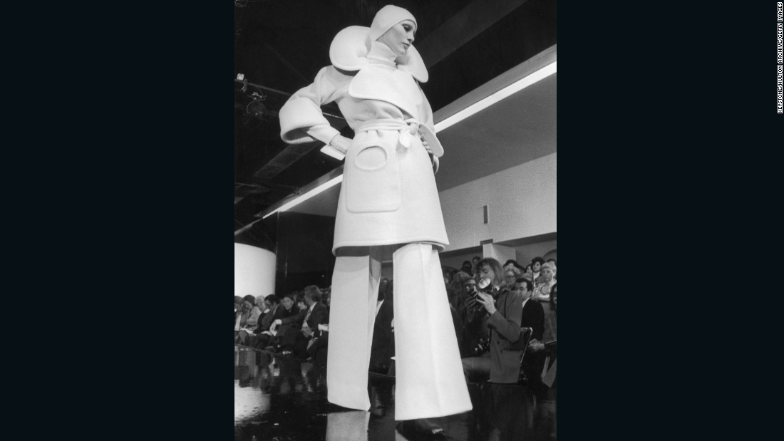"""I'd always admired Cardin because he seemed like such a showman. He was so free, doing these geometric, sometimes abstract designs that were like architecture, which he had studied before he went into fashion."" <br /><em><br />A model walks the runway at Pierre Cardin, 1972</em>"