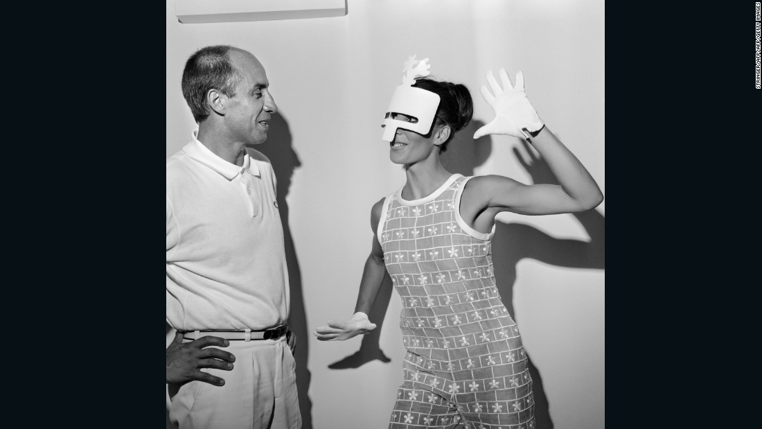 """From early on I was always under the impression that [André Courrèges] was starting a revolution."" <br /><em><br />André Courrèges with a model wearing one of his Haute Couture Autumn-Winter 1967 designs, 1967 </em>"