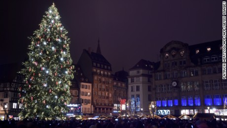 This photo taken on November 27, 2015 in Strasbourg, eastern France, shows a Christmas tree lit up on the opening day of the Christmas market. For security reasons the city center has been closed to car traffic during the whole period of Strasbourg's Christmas market, following the November 13 Paris attacks.  AFP PHOTO / PATRICK HERTZOG / AFP / PATRICK HERTZOG        (Photo credit should read PATRICK HERTZOG/AFP/Getty Images)