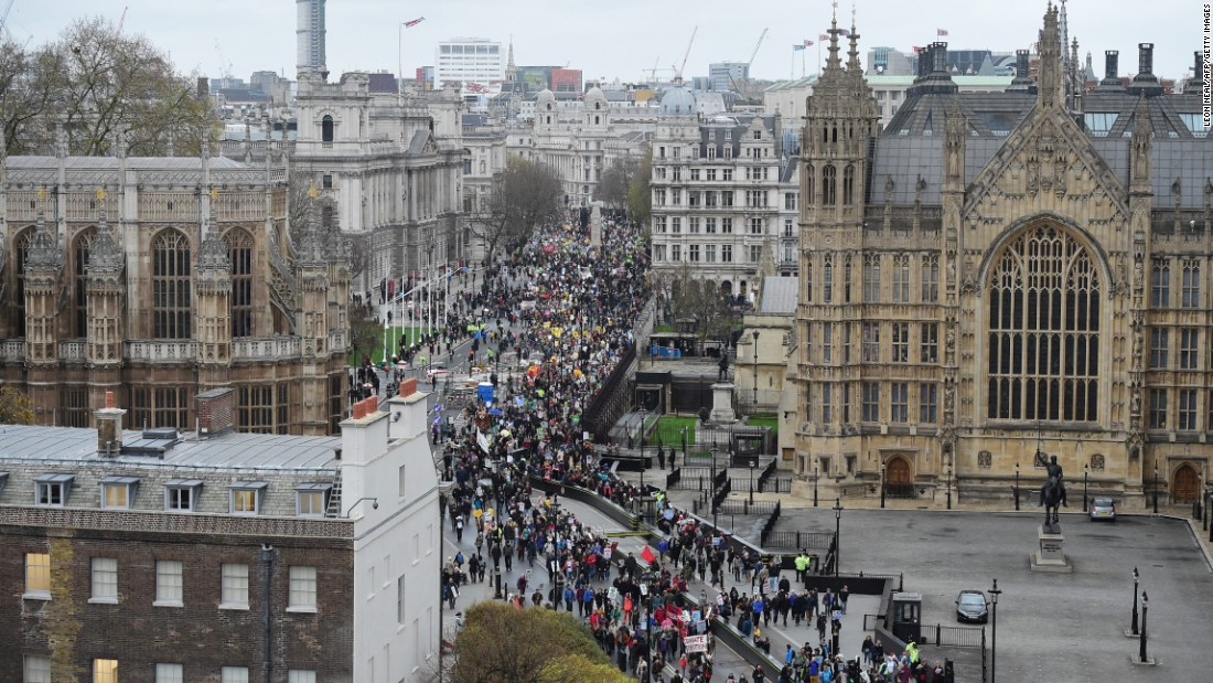 Climate change demonstrators march to demand curbs to carbon pollution in London.