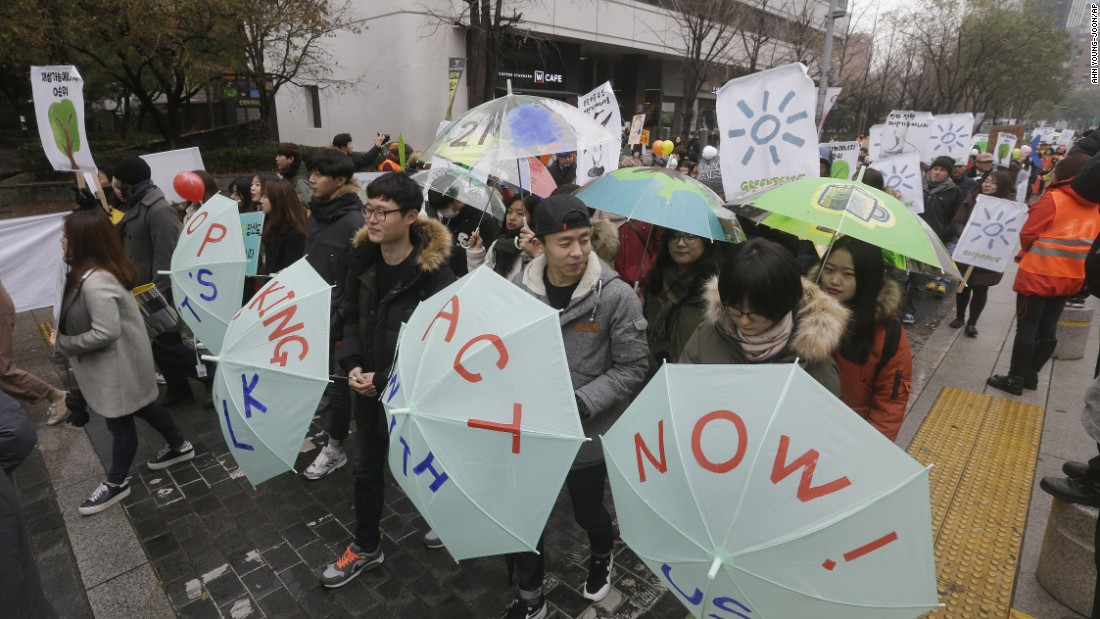 Environmental activists march in Seoul, South Korea.