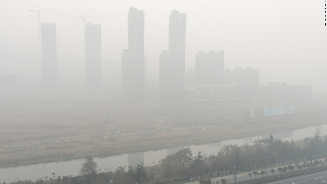 Residential blocks are cloaked in smog in Lianyungang, in eastern China's Jiangsu province, on November 30.