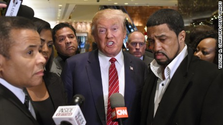 Rev. Darrell Scott, senior pastor of the New Spirit Revival Center in Cleveland Heights (R) and Republican hopeful Donald Trump  speak to the press after a meeting at Trump Tower in New York on November 30 ,2015 with prominent African American clerics.