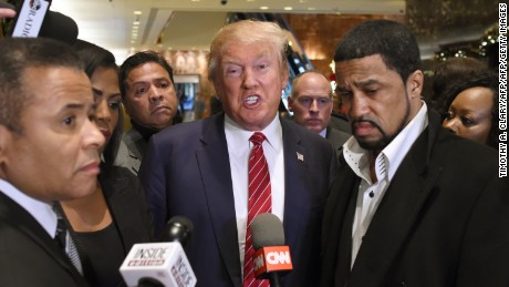 Rev. Darrell Scott, senior pastor of the New Spirit Revival Center in Cleveland Heights (R) and Republican hopeful Donald Trump  speak to the press after a meeting at Trump Tower in New York on November 30 ,2015 with prominent African American clerics. AFP PHOTO / TIMOTHY A. CLARY / AFP / TIMOTHY A. CLARY        (Photo credit should read TIMOTHY A. CLARY/AFP/Getty Images)