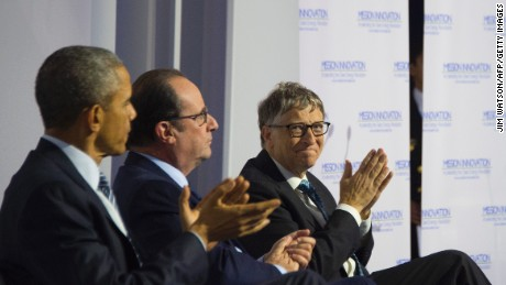 Microsoft co-founder Bill Gates (R)  US President Barack Obama (L) and French President Francois Hollande (C) applaud a speech during the Mission Innovation event at the UN conference on climate change COP21 on November 30, 2015 at Le Bourget, on the outskirts of the French capital Paris.