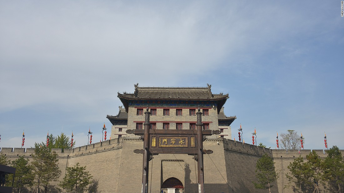 South Gate (pictured) is the oldest and grandest gate. Accessible only through a drawbridge across a moat, each gate consists of a multi-story archer's tower. Other structures like watchtowers and corner towers dot the city wall, making it one of the most impressive defense systems in ancient China.