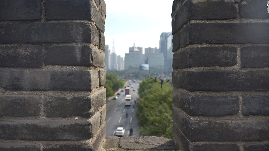The top of the wall offers a unique view of the contrasting faces of this ancient Chinese city.