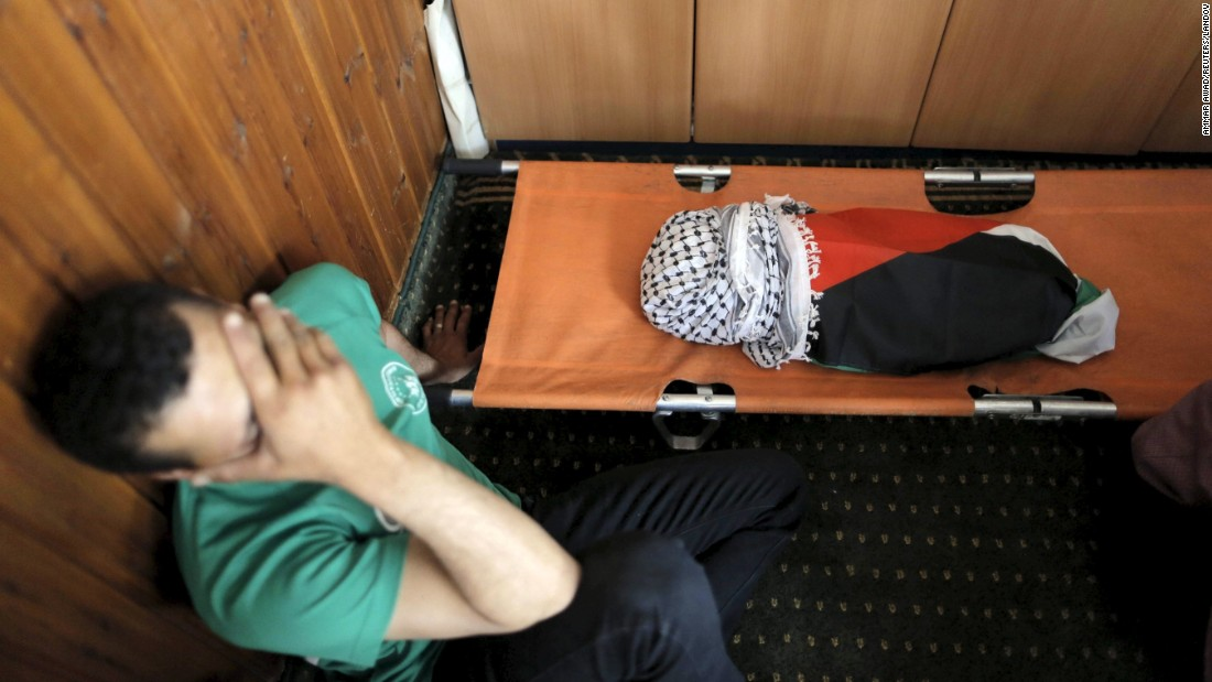 "<strong>July 31:</strong> A mourner reacts next to the body of Ali Saad Dawabsha, an 18-month-old Palestinian who was killed after his family's house in Duma, West Bank, <a href=""http://www.cnn.com/2015/07/31/middleeast/palestinian-price-tag-attack/"" target=""_blank"">was set on fire</a> by suspected Jewish extremists. Authorities found the words ""price tag"" on the walls of the house, said Luba Samri, a spokeswoman for Israeli police. A ""price tag"" attack is a term used by radical Israeli settlers to denote reprisal against Palestinians in response to moves by the Israeli government to evacuate illegal West Bank outposts, according to officials. Both Israelis and Palestinians described it as a terrorist attack, but the latter said it blamed Israel. Israeli Prime Minister Benjamin Netanyahu said he was ""shocked over this reprehensible and horrific"" attack."