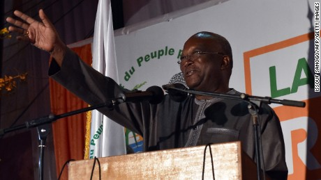 Roch Marc Christian Kabore waves to supporters in Ouagadougou on December 1, 2015 after winning Burkina Faso's presidential election.