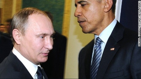 Russian President Vladimir Putin, left, meets with US President Barack Obama on the sidelines of the UN conference on climate change - COP21, on November 30, 2015 at Le Bourget, on the outskirts of the French capital Paris.