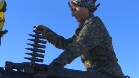 female kurdish soldier loads ammo
