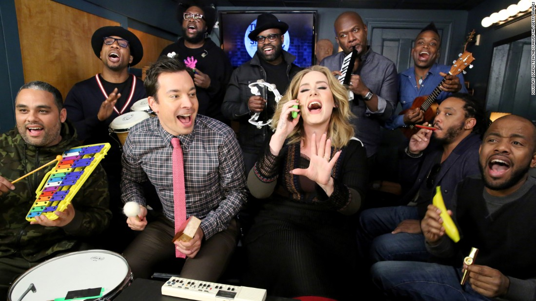 "<strong>November 24:</strong> Singer Adele <a href=""http://www.cnn.com/2015/11/25/entertainment/adele-jimmy-fallon-tonight-show-feat/"" target=""_blank"">performs her hit single ""Hello""</a> as she is accompanied by ""Tonight Show"" host Jimmy Fallon and his house band, The Roots, on classroom instruments."