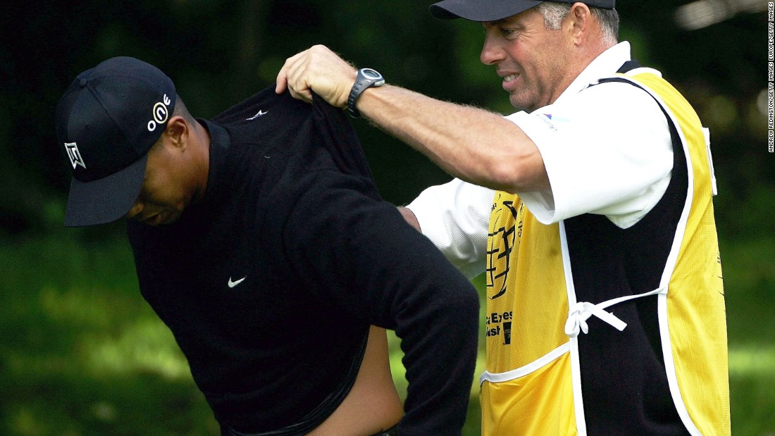The 14-time major winner has a long history of injury problems. Here he has cream rubbed onto his back by caddy Steve Williams during the 2004 American Express Championship.