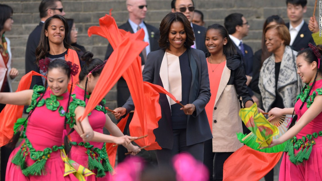"U.S. First Lady Michelle Obama danced with daughters Sasha (right) and Malia (left) during a trip to Xi'an in 2014. ""There you stand, on top of a wall that's hundreds of years old -- a wall that has withstood war and famine and the rise and fall of dynasties,"" she wrote in <a href=""https://www.whitehouse.gov/blog/2014/03/24/first-ladys-travel-journal-visiting-xian-city-wall"" target=""_blank"">her travel journal</a>."