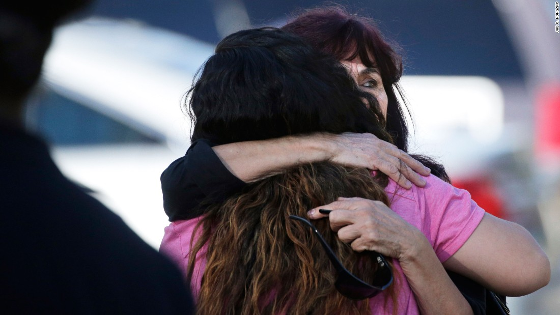 A woman is comforted near the scene of the shooting.