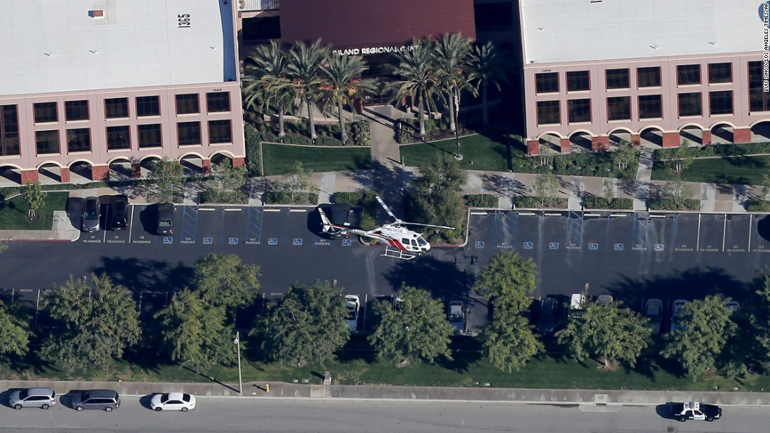 A police helicopter hovers around the Inland Regional Center.