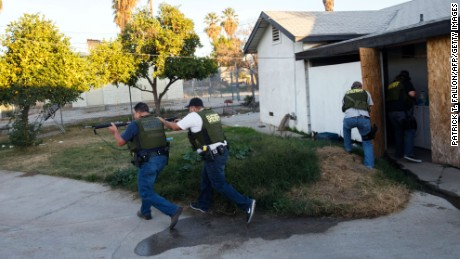 Law enforcement officers search for the suspects of a mass shooting in San Bernardino, California, on Wednesday, December 2.