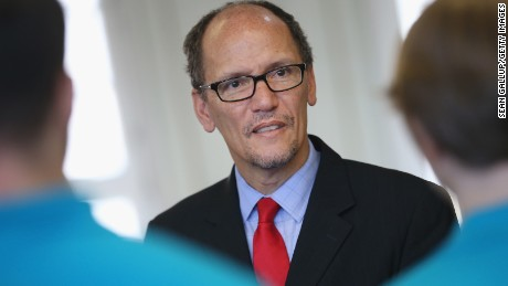 U.S. Labor Secretary Thomas Perez chats with trainees at the Siemens training facility on October 28, 2014 in Berlin, Germany.