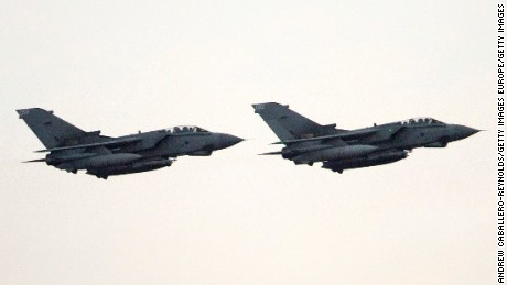 LIMASSOL, CYPRUS:  Two British RAF tornado fighter jets land at RAF Akrotiri after returning from a mission over Iraq in 2014. The British Parliament voted this week to allow the jets to strike in Syria.