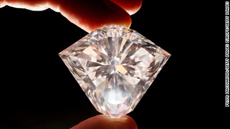 LONDON - FEBRUARY 19:  A Christie's employee displays a colourless diamond of 101.27 carats on February 19, 2008 in London, England. Estimated to sell for a minimum of $6 million, this rare gem is the largest to appear on the auction market in 18 years and will be offered for sale at Christie's forthcoming Spring Hong Kong jewellery sale on May 28, 2008.  (Photo by Peter Macdiarmid/Getty Images)