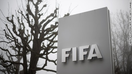 A photo taken on December 3, 2015 in Zurich, shows the sign of the FIFA at the entrance of their headquarters.  In a dramatic widening of the FIFA corruption scandal, Swiss police arrested two more top football officials in a dawn raid Thursday on suspicion that they accepted millions of dollars in bribes. / AFP / FABRICE COFFRINI        (Photo credit should read FABRICE COFFRINI/AFP/Getty Images)