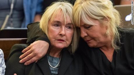 June Steenkamp, left, mother of Reeva Steenkamp, is comforted during proceedings.