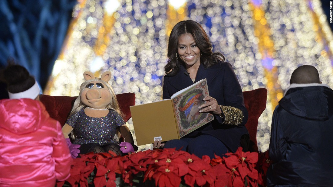 First lady Michelle Obama and Miss Piggy read a children's book from the stage.