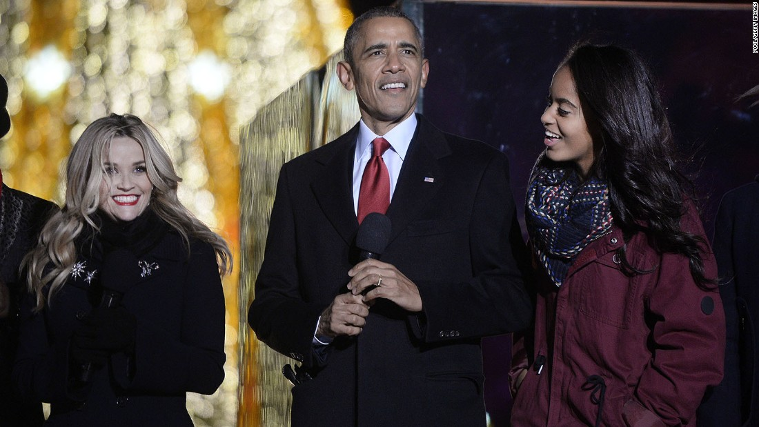 Actress Reese Witherspoon, President Barack Obama and Malia Obama on stage during the National Christmas Tree lighting ceremony on the Ellipse south of the White House on December 3.