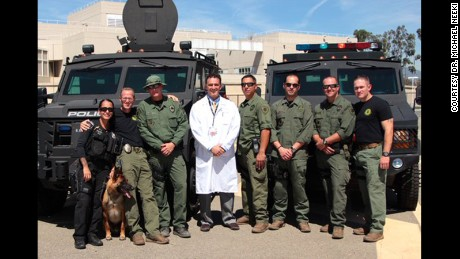 Dr. Michael Neeki, center, with officers in the probation department of San Bernadino County.