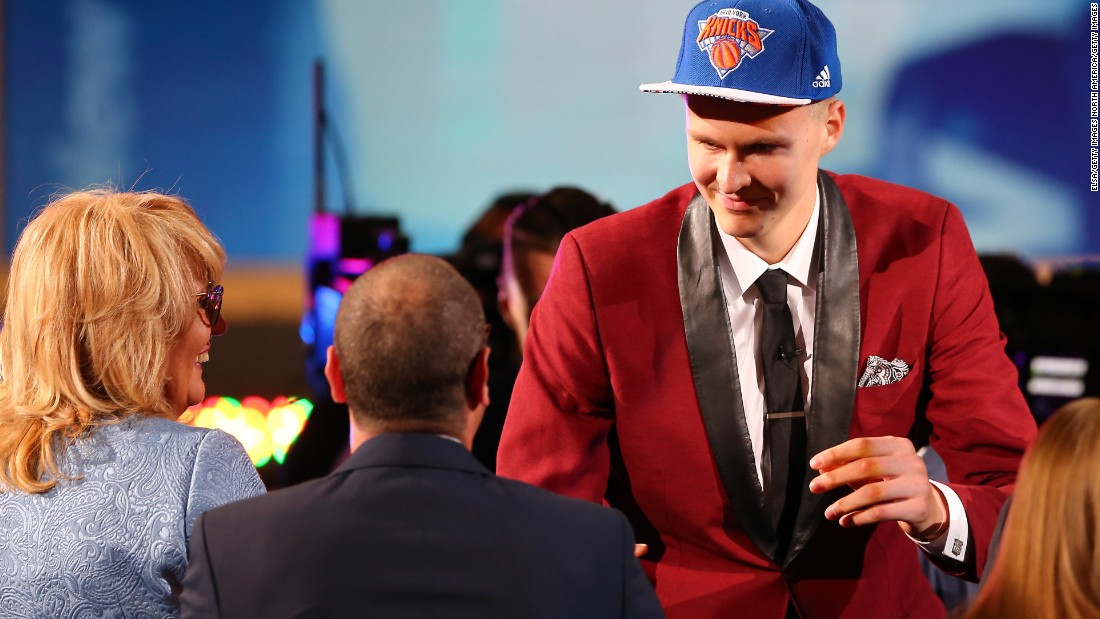 Latvia's Kristaps Porzingis, the Knicks' new 7-foot 3-inch center, celebrates after being selected fourth overall.