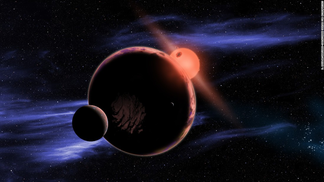 This artist's conception shows a hypothetical planet with two moons orbiting in the habitable zone of a red dwarf star. The majority of the sun's closest stellar neighbors are red dwarfs.