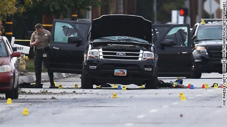 SAN BERNARDINO, CA - DECEMBER 03:  Law enforcement officials investigate around the Ford SUV vehicle that was the scene where suspects of the shooting at the Inland Regional Center were killed on December 3, 2015 in San Bernardino, California. Police continue to investigate a mass shooting at the Inland Regional Center in San Bernardino that left at least 14 people dead and another 17 injured on December 2nd.  (Photo by Joe Raedle/Getty Images)