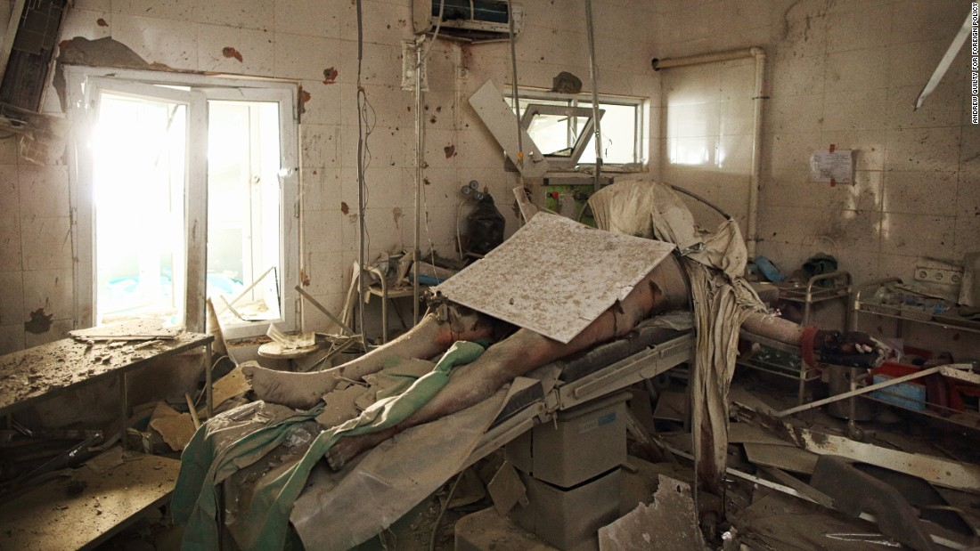 "<strong>October 10:</strong> Baynazar Mohammad Nazar lies dead on an operating table inside the Doctor's Without Borders Trauma Center in Kunduz, Afghanistan. He was killed during a U.S. airstrike that killed 30 people, including hospital staff, patients and possibly members of their families visiting the facility at the time of the attack. His was one of several bodies that <a href=""https://foreignpolicy.com/2015/12/03/the-man-on-the-operating-table-msf-hospital-kunduz-afghanistan-us-airstrike/"" target=""_blank"">remained in the hospital for more than a week</a> as ongoing fighting between Taliban and Afghan government forces prevented access to the center."