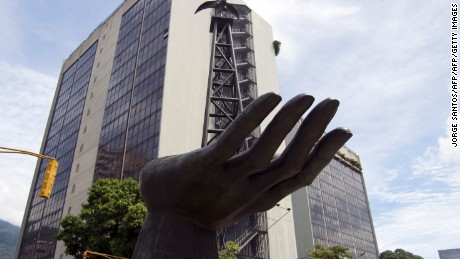 A statue depicting an oil drilling rig is seen in front of PDVSA (state owned oil company) in Caracas on November 03, 2009. Energy Minister Rafael Ramirez said Venezuela will propose to mantain actual production level at the OPEP meeting in Angola next December.  AFP   PHOTO/Jorge Santos (Photo credit should read JORGE SANTOS/AFP/Getty Images)