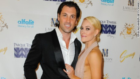 "Maksim Chmerkovskiy and Peta Murgatroyd married the same day as fellow ""Dancing With the Stars"" star Julianne Hough."