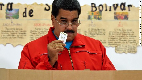 Venezuelan President Nicolas Maduro prepares to cast his vote in Caracas, on December 6, 2015 during legislative election. Venezuelans voted Sunday in tense elections that could see the opposition seize legislative power from the socialist government in the oil-rich, cash-poor nation.    AFP PHOTO / JUAN BARRETO / AFP / JUAN BARRETO        (Photo credit should read JUAN BARRETO/AFP/Getty Images)
