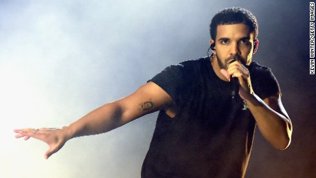 INDIO, CA - APRIL 12:  Rapper Drake performs onstage during day 3 of the 2015 Coachella Valley Music & Arts Festival (Weekend 1) at the Empire Polo Club on April 12, 2015 in Indio, California.  (Photo by Kevin Winter/Getty Images for Coachella)