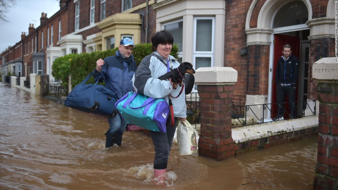 Local residents in Carlisle leave their homes December 6.