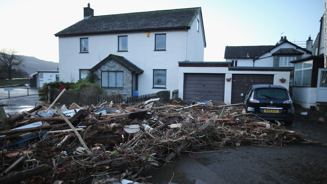 A pile of debris is pictured December 6 outside a house in Keswick, northern England, as people begin the cleaning up after flooding.