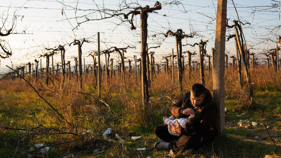 A migrant father holds his daughter after crossing the Greek-Macedonian border near the town of Gevegelija, Macedonia, on December 4.